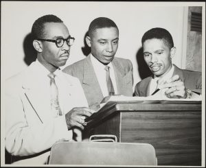 Lee (right) and McKissick (middle) with unidentified litigant. Photo by Alex Rivera, Jr.