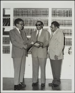 Lee making presentation to Theodore R. Bryant, North Carolina Central University Law School alumnus.